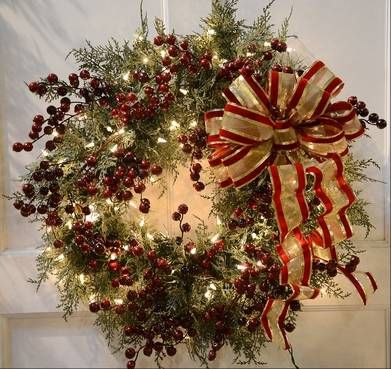 Cedar wreath with berry picks and weather resistant bow