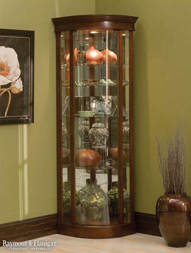 Perfect for smaller spaces, this Auberge corner curio with lighting in warm cherry gives you a great place to display your collectibles without taking up too much square footage.