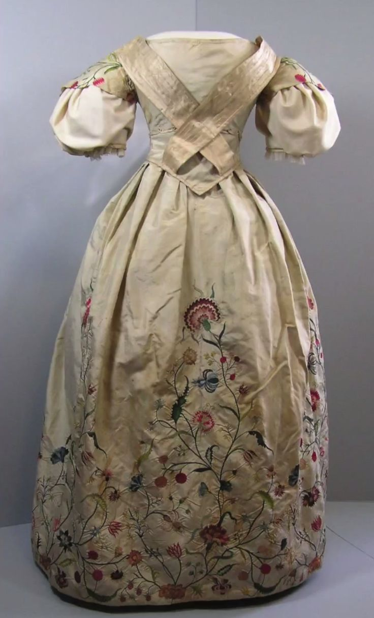 Wedding dress 1735. Pale celadon green Chinese silk, with silk embroidery by the bride, Elizabeth Bull, begun in her mid-teens and still not finished when she married aged 18/19. Remodelled/up-dated at least twice and much-worn, too fragile for regular display. Bostonian Society Collections