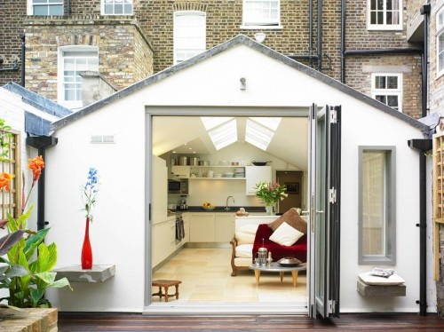modern addition on a row of town homes in London. LOVE this new kitchen open to an outdoor terrace