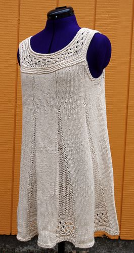 Fluted Tunic - pleats worked sideways with textural stitches and small amount of lace. Stocking stitch panels worked horizontally and the pleats are picked up the panels and worked vertically. Top is worked in round for bust and vertically for yoke lace.