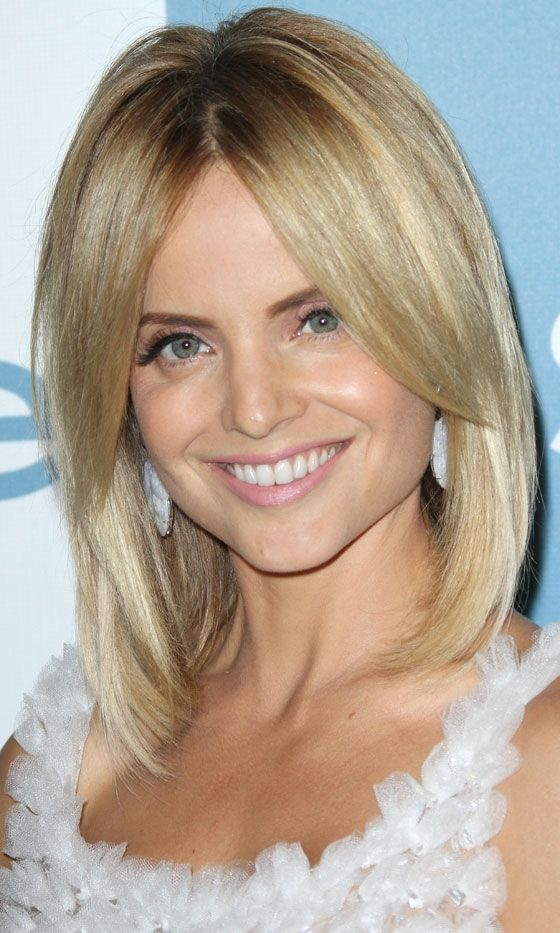 Mena Suvari's bob. Love the middle part and strong bangs
