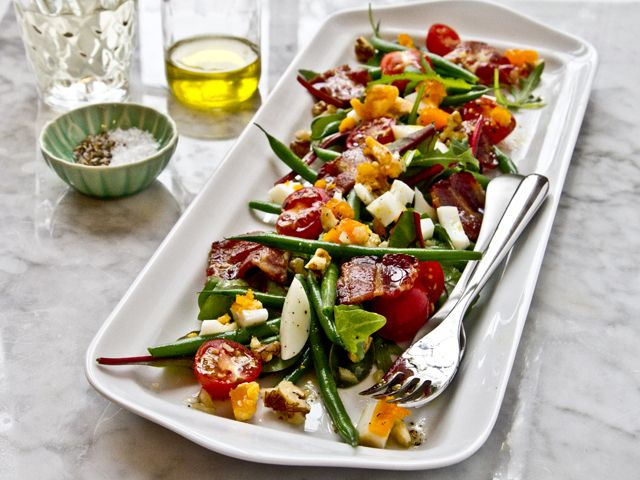 Paris bistro salad  with green beans, walnuts, chopped egg and pancetta and drizzled with a walnut vinaigrette.