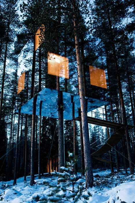 The Mirrorcube by Tham & Videgård Arkitekter. A tree hotel in the far north of Sweden, near the small village of Harads, close to the Arctic Circle. A shelter up in the trees; a lightweight aluminium structure hung around a tree trunk, a 4×4x4 meters box clad in mirrored glass. The exterior reflects the surroundings and the sky, creating a camouflaged refuge. The interior is all made of plywood and the windows give a 360 degree view of the surroundings.