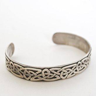 Sterling silver Celtic cuff by Simon Wroot (Calgary, AB). Member of the Alberta Craft Council.