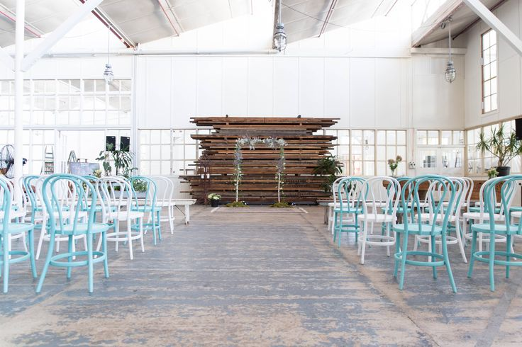 Industrial warehouse space softened by cool colours and beautiful flowers for this casual North Melbourne wedding 2016