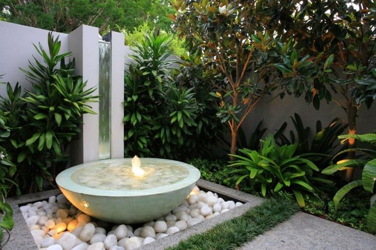 Gorgeous low-bowl container fountain including submersible lights. You can often find a container fountain kit online where the fountain base also includes lights so it's not necessary to buy separately.