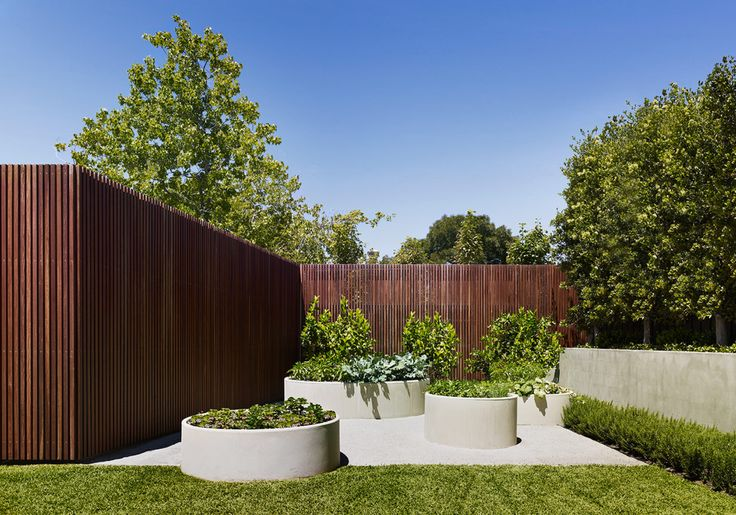 Concrete pipe planters with herbs and veg Jack Merlo - Photo: Peter Carke