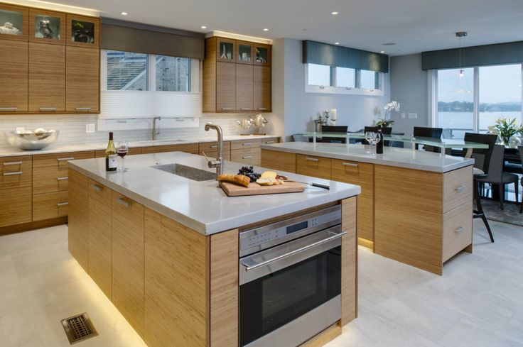 Modern Kitchen With Bamboo Cabinets And Quartz Countertops.