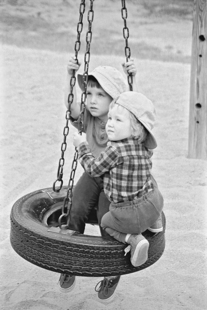 Owen and Isobel on a swing by their home in Nova Scotia (photo: Dave Melnychuk)