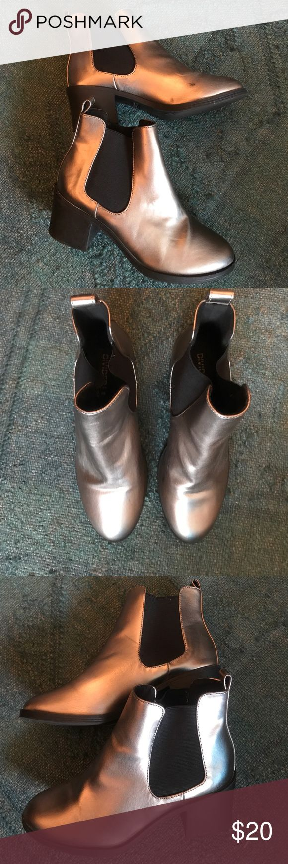 Silver metallic booties with heel From H&M divided, slightly worn booties silver metallic. As shown in photo there's a worn spot (black), on the inner area near toe. That's the only flaw, so this price is a steal! Size 8 US Divided Shoes Ankle Boots & Booties