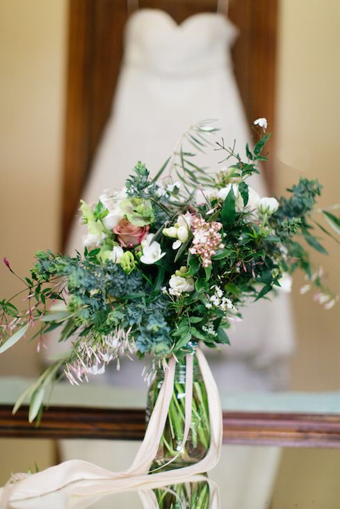Tara's loose, unstructured bouquet features white freesia, ranunculus, dusty pink roses, green hellebores, olive foliage and flowering viburnum, finished with trails of budded star jasmine vine and long cream silk ribbon. www.jademcintoshflowers.com.au www.tracybeveridgephotography.com.au