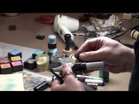 Watch along as Tim demos his new Distress Marker Spritzer at the Winter CHA 2014 show. The perfect tool for creating airbrush effects on craft projects, the Tim Holtz Distress Marker Spritzer was named a CHA Hot 20 Award winner!