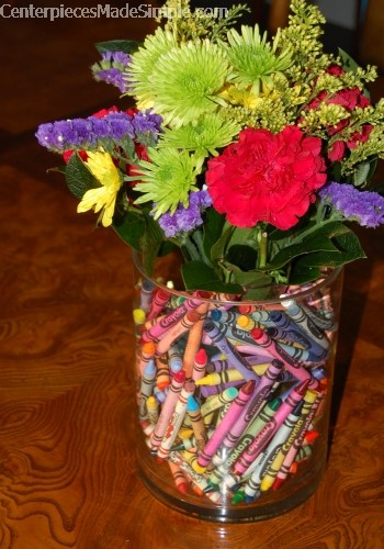 Nest two vases and add crayons and flowers for the teacher, I've also seen this with beads, marbles, rice, etc.