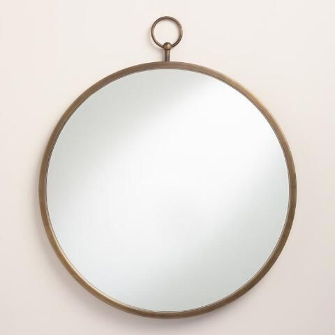 Topped with a loop embellishment, our round mirror is finished in antique brass and includes a matching knob for a seamless vintage look.