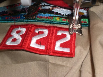 Sewing Scout Patches Tips and Tricks. If you don't want to click and read it, she said sew the numbers together first. The second tip was taping the badges on with masking tape, sewing them on, then peel the tape off.