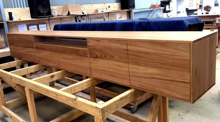 This custom 3.5m long TV unit is designed by Bombora Custom Furniture to be wall hung. The pale tones of the Blackbutt timber used maintains a certain lightness to the unit. #bomboracustomfurniture #customtvunit #blackbuttfurniture