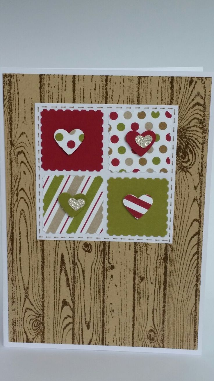 Rustic four stamped hearts on woodgrain background card