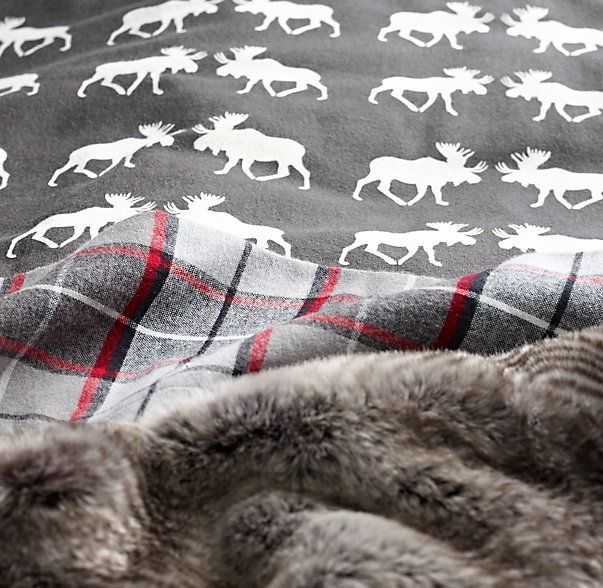 flannel bedding in a moose motif paired with faux fur. for the coziest winter dent. #rhbabyandchild