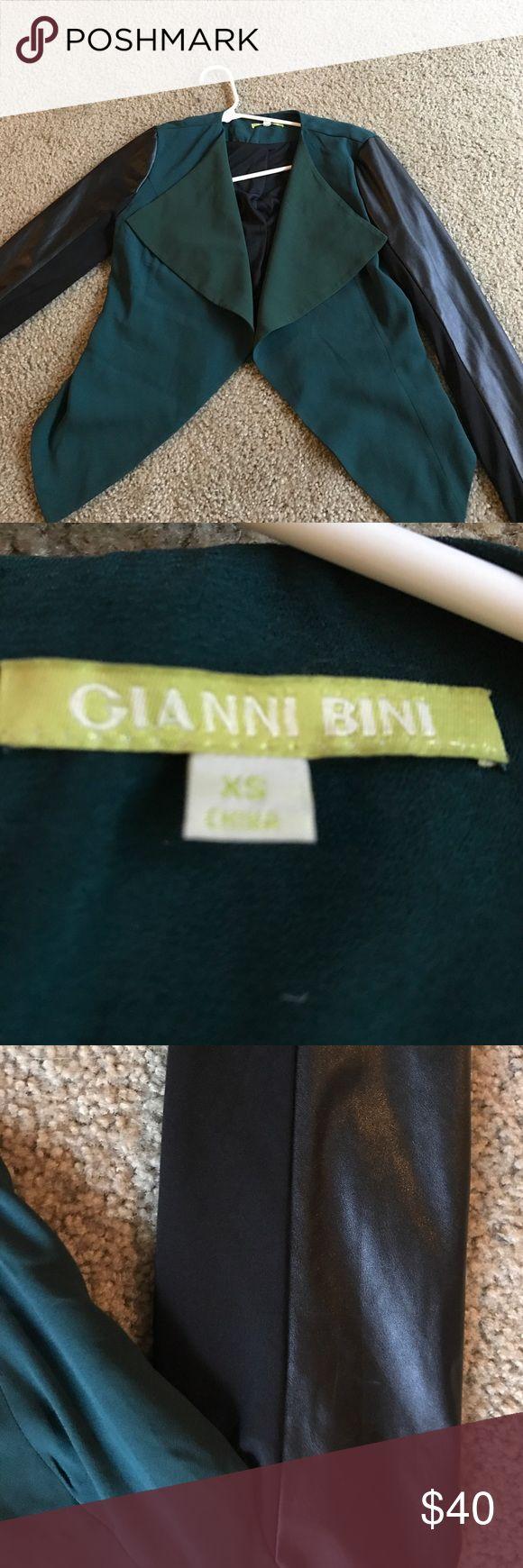 A Gianni Bini Blazer A green Gianni Bini Blazer with pleather detailed sleeves. Size XS Gianni Bini  Jackets & Coats Blazers
