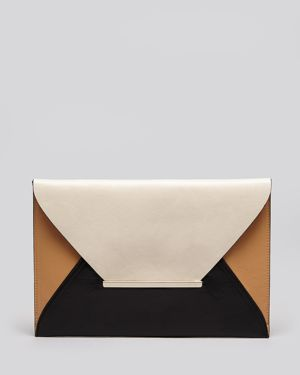 great clutch to wear with our MACKENZIE winter top from #kymerah.com
