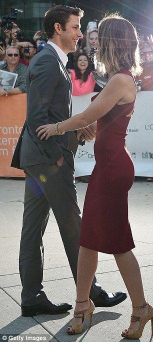 Emily Blunt in a curve hugging dress and cork heels gives a great profile.