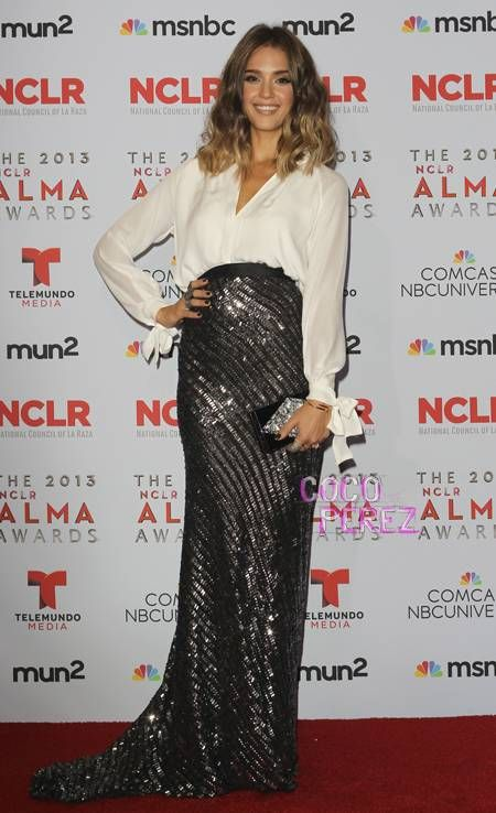 Jessica Alba pairs a sparkly skirt with a white long-sleeved blouse at the NCLA ALMA Awards!
