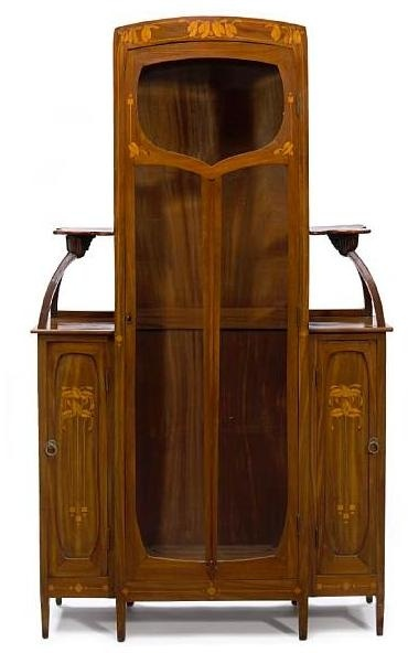 A Continental Art Nouveau inlaid marquetry, walnut and beveled glass display cabinet circa 1900