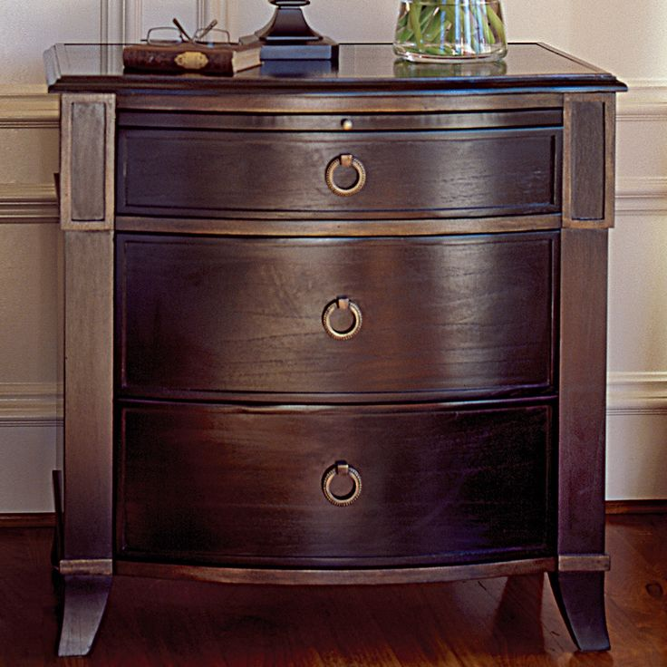 the nightstand boasts warm and classic style rich in a grained espresso finish the wood bowed front and serpenti