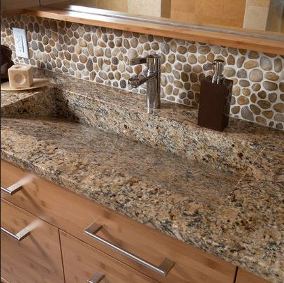 I love the backsplash idea for the bathroom, but not in combination with the color of the granite....