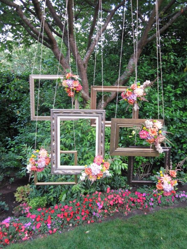 Hanging frames for make-shift photo booth!! Will use with Polaroid cameras YES! Just too much pink in the flowers. Maybe no flowers and combo of gold and wood frames.