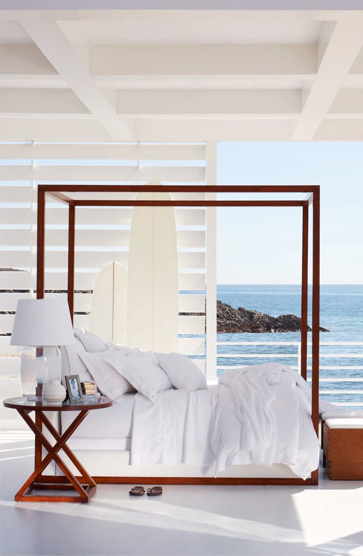 Soothing by the sea, Ralph Lauren Home's Desert Modern Canopy Bed covered in crisp white linens