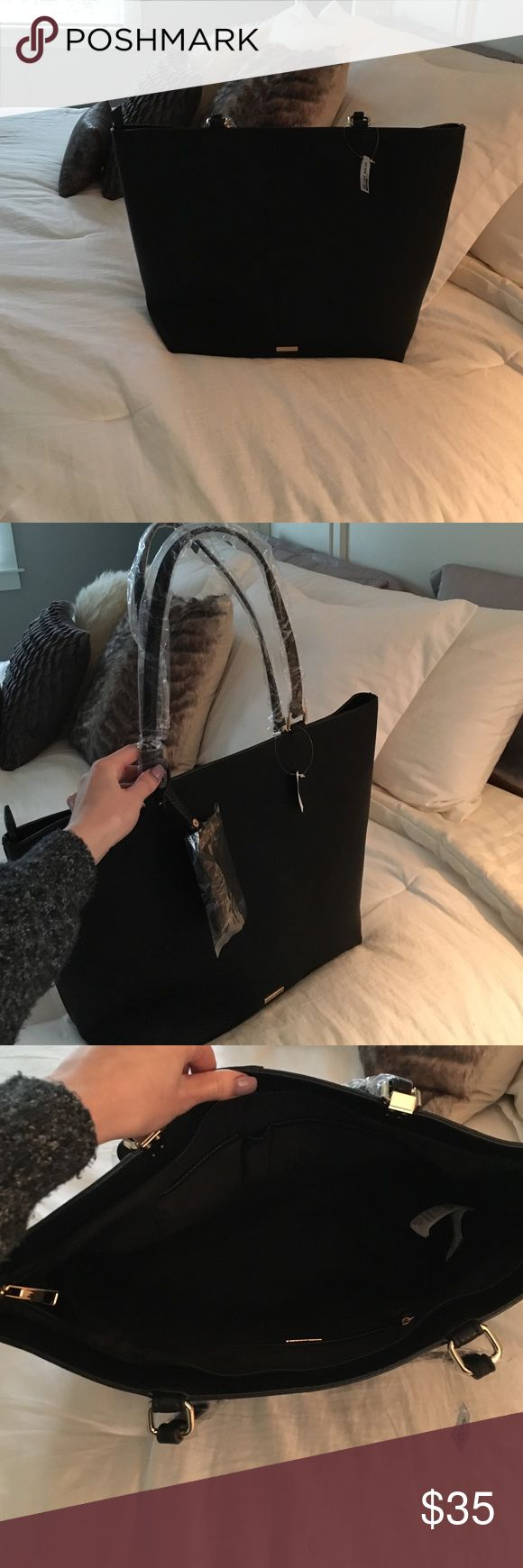Black Aldo handbag 💕 All black handbag with gold detail ❤ love this but I got 2 of the same for christmas😂 you can use it as a handbag or tote !!! brand new with tags 🙋 Aldo Bags Shoulder Bags