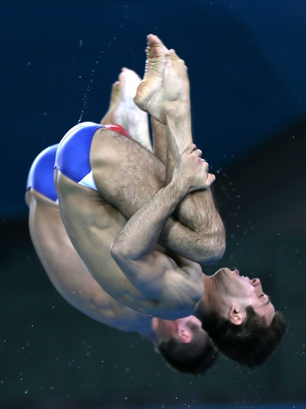 Americans Nicholas Mccrory and David Boudia brought home the Bronze Medal in the Men's Synchronized 10m Platform Diving event on Day 3 of the London 2012 Olympic Games. What a photo this is! (Photo: Clive Rose/Getty Images)