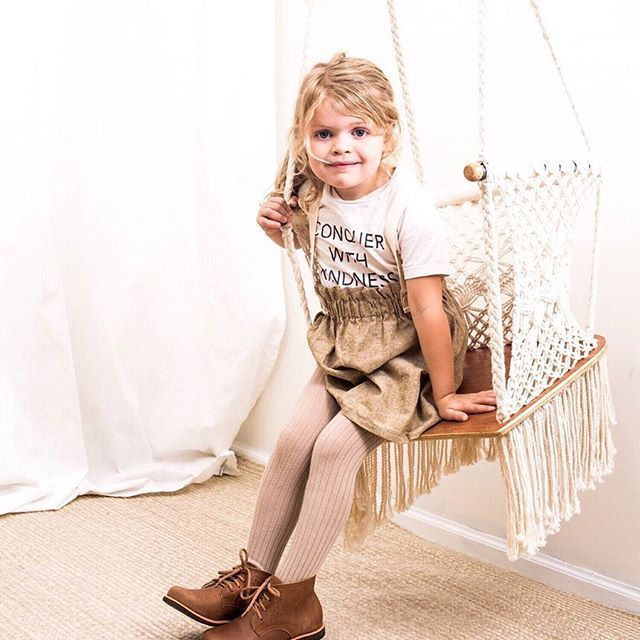 Gorgeous Adelisa & Co. handmade, macramé hammock swing with wooden seat. Our macramé hammock swings are handmade in Nicaragua by talented artisans. With beautifully crafted wooden bars and beautiful cream coloured cotton, these Adelisa & Co. macramé chair swings are the perfect neutral item for your home. Whether it's for a playroom, nursery, or living room- this swing will fit beautifully with any type of décor. This swing can also be used outdoors making it the perfect porch swing.