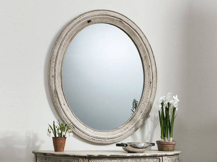 Enhance your décor with Stoddard Oval Cream Wall Mirror which is much more useful than just for checking how your hair's looks.