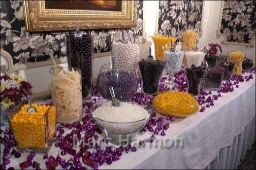wedding candy bars display | black yellow purple and white for a halloween candy buffet