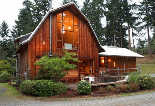 This beautiful project in Whidbey Island, Washington took an old barn and revamped it into something truly spectacular. Designed and built by the up and coming Seattle firm, Shed Architecture & Design, the barn was magically transformed into a unique living space and guest house. Old wood from the exterior is reclaimed and reused inside the home.