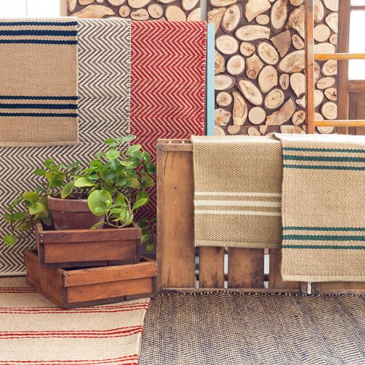 An easy-care, eco-friendly rug in a goes-with-anything, classic stripe? It's true! This durable indoor/outdoor area rug, in a deep beige with narrow red stripes, is a natural fit for the lake house, the cabin, or home, sweet home!