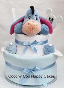 Our Eeyore Nappy Cake, is an ideal baby gift or baby shower present..  This handmade Nappy Cake is made with tender care and comes wrapped in cellephane,making this a perfect gift using baby clothing items to make this stunning looking Nappy Cake. #nappycakes #babyshower #babyshop #babygifts