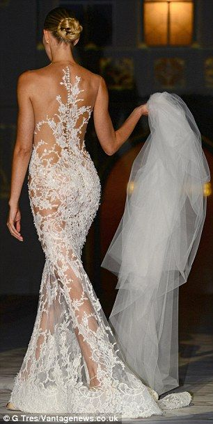 Sheer beauty: Karolina Kurkova modelled a see-through and racy lace-embroidered gown by Pronovias during Barcelona Bridal Week in Spain on F...