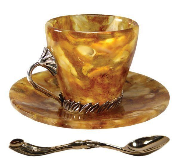 An antique Russian amber tea cup and saucer set. I also like the shape of the spoon. I would think quite an eloquent feeling when having tea at this setting!
