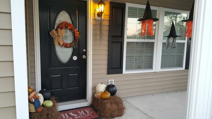Fall/Halloween theme. pine straw instead of hay bales. Craft pumpkins from Michael's for $6 a piece (on sale). little pumpkins in the front are real. To complete the look with floating witch hats!