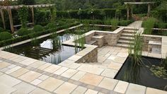 Eye level pond with sunken patio Pangbourne Berkshire.