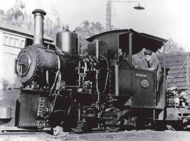 Wee Georgie Wood standing at Tullah, with driver Bill Winskill looking out of the cab.