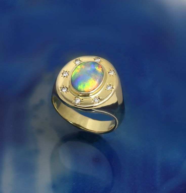 Mens Black Opal Ring in 18ct Gold set with 8 Diamonds.