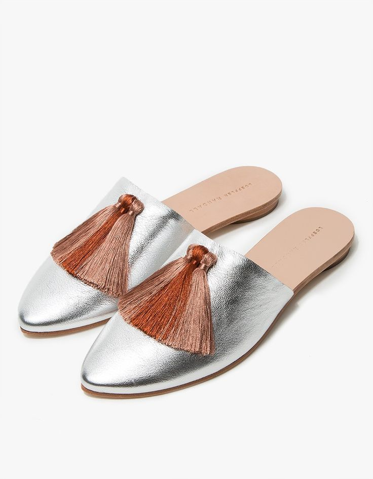 Slide from Loeffler Randall. Silver goatskin upper with silky Pink Clay tassel accents at vamp. Pointed toe. Low rounded heel.  • Leather upper • Leather sole  • Made in Brazil