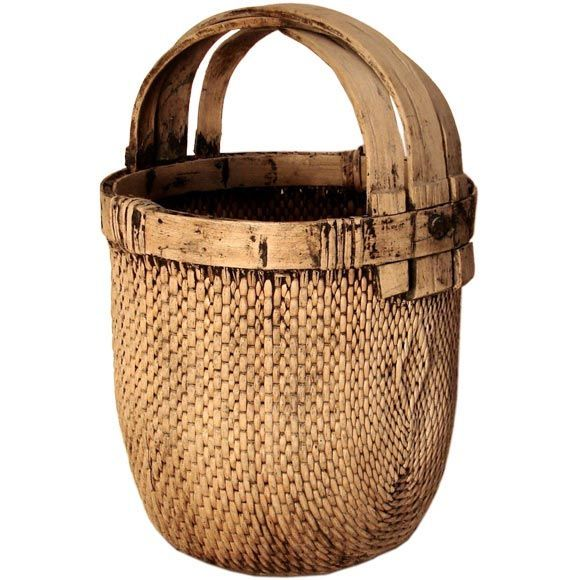"""Chinese water hyacinth basket sealed with """"pitch"""" to carry water or grain. Mid 20th cent."""