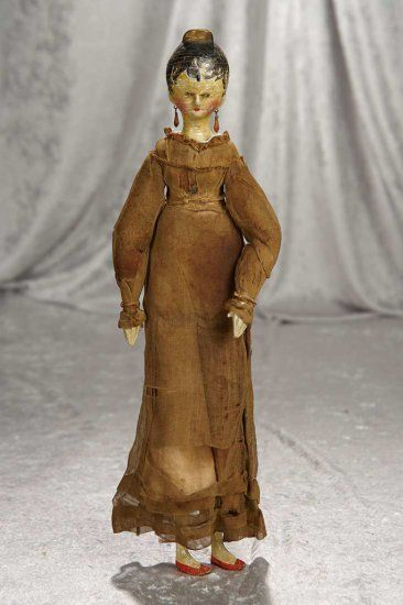 "15"" Early Grodnertal wooden doll with gold tuck comb and articulated wooden body. $400/600"