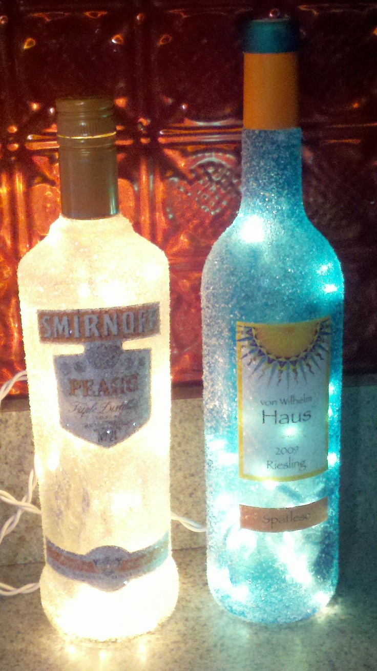 Wineliquor bottles brushed with glue sprinkled with